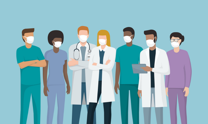 Graphic image of clinical team with masks talking to eachother_840x500.png