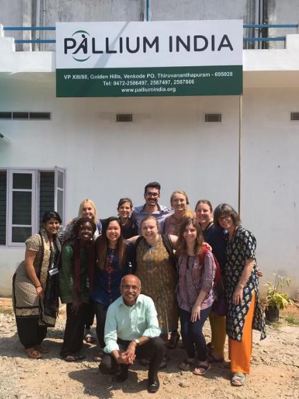 Pallium India group photo taken outside of a Pallium India clinic in Trivandrum