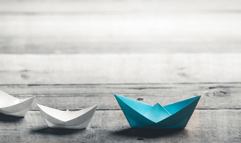 Paper boats signifying leadership - blog - v2 - 840x500.png